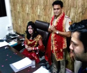 Radhe Maa dances with police officers, two suspended