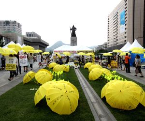 People march on April's ferry Sewol disaster
