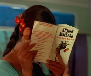 "Sharmila Tagore\'s character in ""Aradhana\"" with her copy of an Alistair MacLean novel as Rajesh Khanna serenades her with \""Mere Sapnon ki Rani...\"""