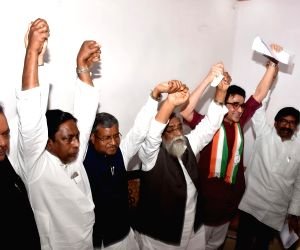 Shibu Soren, Hemant Soren (JMM), Ajay Kumar, Subodh Kant Sahay (Congress), Babulal Marandi (JVM-P) during a joint press conference, in Ranchi, on March 24, 2019. The Congress, the Jharkhand ...