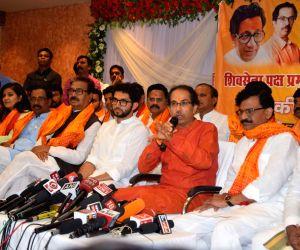 Shiv Sena President Uddhav Thackeray accompanied by party leader Sanjay Raut and Yuva Sena President Aditya Thackeray addresses a press conference in Uttar Pradesh's Ayodhya, on June 16, ...