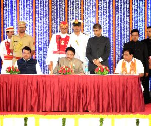 Shiv Sena's Tanaji Sawant along with Maharashtra Governor CH Vidyasagar Rao and Chief Minister Devendra Fadnavis, after taking oath as a Cabinet Minister during a swearing-in ceremony, in ...