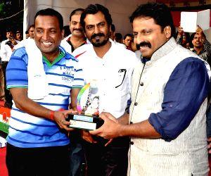 Arjun Rampal celebrating Dahi Handi festival at Politician Sanjay Nirupam's Dahi Handi