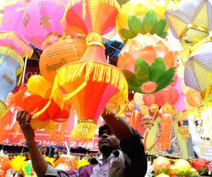 Shopkeepers busy selling lanterns and `diyas` ahead of Diwali - festival of light in Bangalore on Oct.29, 2013.