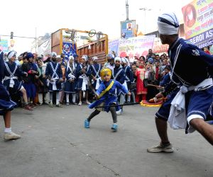 Sikh nihangs display their Gatka skills on the eve of Guru Nanak Jayanti in New Delhi, on Nov 24, 2015.
