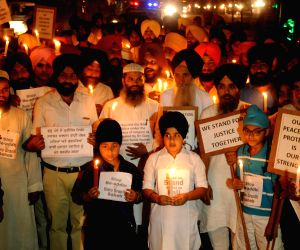 Sikhs hold a candlelight vigil to protest against desecration of Guru Granth Sahib