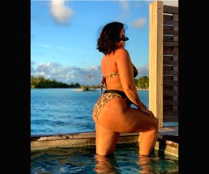 """Singer Demi Lovato says she faced her biggest fear by sharing an unedited bikini photograph. Lovato shared the unedited shot on Instagram on Thursday, and explained the reason behind going """"authentic"""" on social media."""