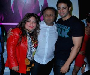 Small-screen actress Dolly and a friend with model-turned-actor Zulfi Sayed (L-R) at the Hi Lounge reopening in Mumbai.
