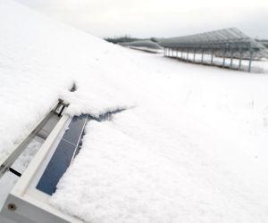 Snow covers solar panels at the solar farm