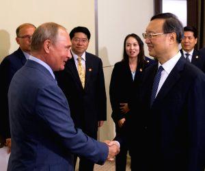 RUSSIA-SOCHI-PUTIN-CHINA-YANG JIECHI-MEET