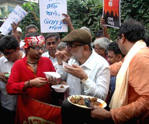 Social activists' demonstration against hike in prices of essential commodities