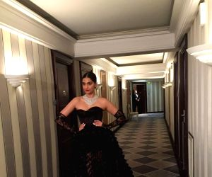 Sonam opts for 'sheer' black fun for Chopard party