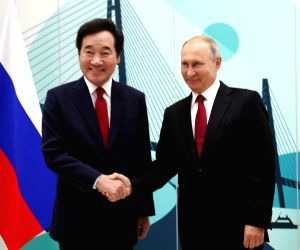 South Korean Prime Minister Lee Nak-yon (L) meets Russian President Vladimir Putin in Vladivostok, Russia, on Sept. 12, 2018, on the sidelines of an annual economic forum under way in ...