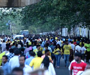 Spectators arrive at M. A. Chidambaram Stadium ahead of an IPL 2018 match between Chennai Super Kings (CSK) and Kolkata Knight Riders (KKR) in Chennai, on April 10, 2018.