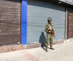 :Srinagar: A soldier stands guard on a Srinagar road during a protest shutdown called by Joint Resistance ership (JRL), a separatist conglomerate headed by Syed Ali Geelani, Mirwaiz Umer Farooq ...