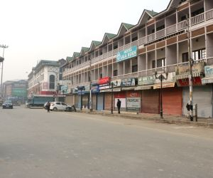 :Srinagar: Roads wear a deserted look during a strike called by Joint Resistance ership (JRL), a separatist conglomerate headed by Syed Ali Geelani, Mirwaiz Umer Farooq and Yasin Malik in ...