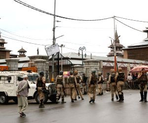 : Srinagar : Security beefed up in Srinagar after four militants including ISJK chief Dawood Salafi alias Burhan were killed in a gun fight with security forces, on  June 22, 2018. A civilian and a ...