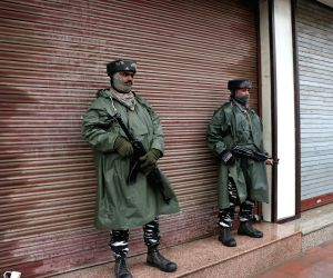 Srinagar: Security personnel stand guard during a shutdown called by separatists to protest against the death of a youth in police custody, in Srinagar on March 20, 2019. Life across the Valley was adversely affected with shops, public transport, oth