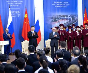 ST.Chinese President Xi Jinping attends a ceremony at which he is awarded an honorary doctorate from Russia's St. Petersburg State University in St. Petersburg, ...