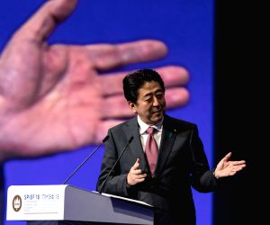 ST. Japanese Prime Minister Shinzo Abe addresses a plenary session during the 22nd St. Petersburg International Economic Forum (SPIEF) in St. Petersburg, May 25, ...