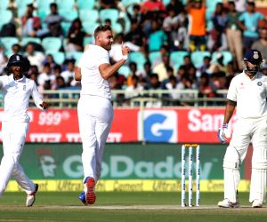 Stuart Broad of England celebrates the wicket of Murali Vijay of India during day three of the 2nd test match between India and England at the Dr. Y.S. Rajasekhara Reddy ACA-VDCA ...