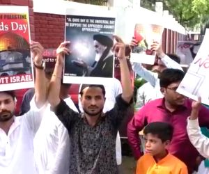 Students of the Aligarh Muslim University (AMU) stage a demonstration on International Quds Day - observed on the last Friday of Ramadan, the annual event that was initiated by the Islamic ...