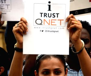 demonstration against QNet MLM scam