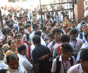 Students wait outside their exam center to appear for their class 12th Board exams in Bengaluru on Mar 1, 2018.