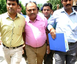 Sudhir Sharma being taken to jail