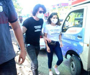 :  Sunny Leone & Husband Daniel Weber Distributing Food To The Poor In Bandra East in Mumbai