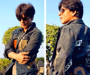Superstar Shah Rukh Khan is inspired by the fashion sense of his close friend and filmmaker Karan Johar, and says he is trying to match up to it.