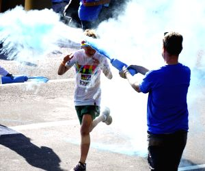 People attend the happy Color Run in Sydney