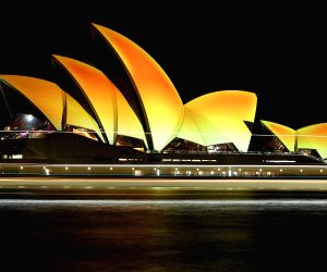 SYDNEY, Oct. 21, 2016 - Photo taken on Oct. 21, 2016 shows the Sydney Opera House is illuminated gold to celebrate Diwali, the Hindu festival of lights in Sydney, Australia. The iconic sails of the ...