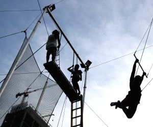 A flying trapeze student swings in the Flying Trapeze Philippines School, Taguig City