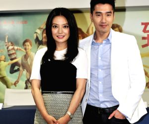 Actress and director Zhao Wei with actor Mark Chao as they attend a press conference