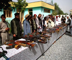 :Taliban fighters attend a surrender ceremony in Bati Kot district of Nangarhar province, Afghanistan, on Oct. 10, 2018. About 75 Taliban rebels renounced ...