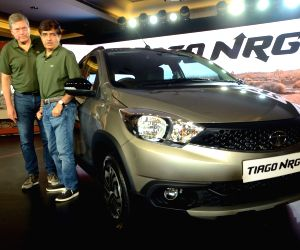 "Tata Motors CEO and MD Guenter Butschek and Tata Motors President (Passenger Vehicle Business Unit) Mayank Pareek at the launch of ""Tiago NRG"" in Mumbai on Sept 12, 2018."