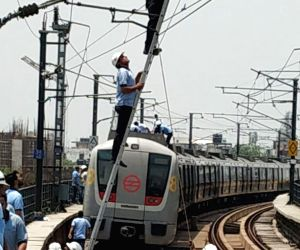 Technicians from the maintenance teams of Delhi Metro Rail Corporation (DMRC) rectify technical glitches that led to delay in services in Delhi Metro's Yellow Line, that runs between Huda ...
