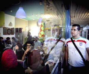 Iranian soccer fans cheer