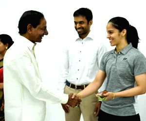 Telangana Chief Minister K Chandrashekhar Rao felicitates shuttler Saina Nehwal who represented India in the recently concluded Commonwealth games 2018, in Hyderabad on April 21, 2018.