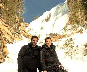 Handout Release: Roger Federer, Bear Grylls in Alps