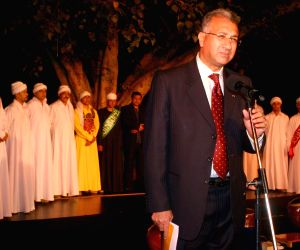"""The Egypt Ambassador to India Dr Higazy with with the Egyptian folk troupe """"Al Tannoura"""" during the International Festival of sacred arts at Indira Gandhi National Centre for Art, in New Delhi on Saturday New Delhi 6 March 2010."""
