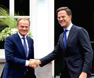 THE HAGUE, June 23, 2018 - Dutch Prime Minister Mark Rutte (R) shakes hands with visiting European Council President Donald Tusk in the Hague, the Netherlands, June 22, 2018. Mark Rutte received ...