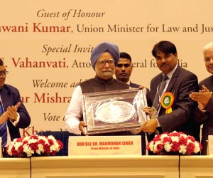 The Prime Minister Manmohan Singh being presented a memento by the Chairman, Bar Council of India, Manan Kumar Mishra at the Golden Jubilee Celebrations of Bar Council of India, in New Delhi on Feb. .