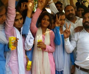 The students, who were on a hunger strike for a week to demand upgradation of the government school in their village to Class 12, celebrate after the Haryana government acceded to their ...
