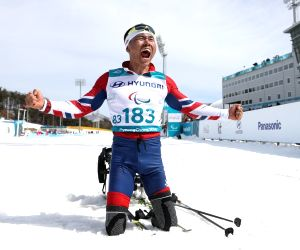 Sitting cross-country skier Sin wins gold