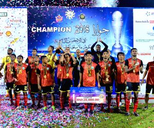 Timor-Leste's players celebrate during the awarding ceremony after the ASEAN Youth Football tournament final between Timor-Leste and Cambodia in Bandar ...