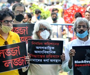 TMC activists protested against the Election Commission during the State Assembly Election in front of Gandhi Statue in Kolkata