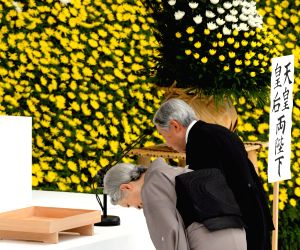 Japanese Emperor Akihito and Empress Michiko attend an annual memorial service for Japan's war dead in Tokyo