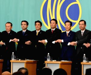 Tokyo (Japan): Japanese Prime Minister Shinzo Abe and presidents of opposition parties pose for a group in the Japan National Press Club